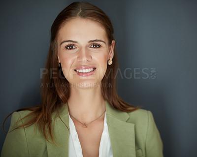 Buy stock photo Studio portrait of an attractive young businesswoman posing against a grey background