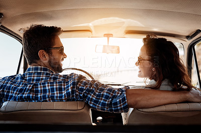 Buy stock photo Rearview shot of an affectionate couple enjoying a summer road trip