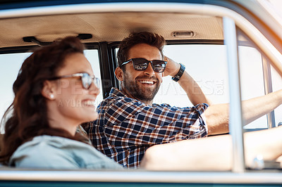 Buy stock photo Cropped shot of an affectionate couple enjoying a summer road trip