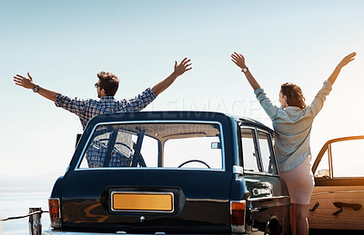 Buy stock photo Rearview shot of a cheerful couple out on a road trip
