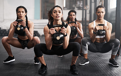 Buy stock photo Shot of young women working out in the gym