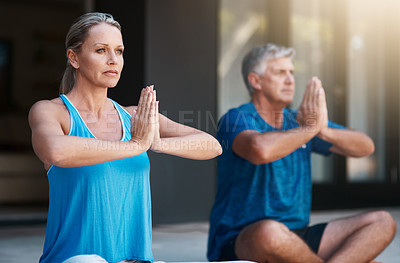 Buy stock photo Shot of a mature and happy couple meditating outside of their home in the morning