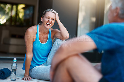 Buy stock photo Shot of a mature and happy couple taking a break after an intense workout session outside of their home