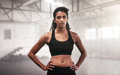 Buy stock photo Portrait of a sporty young woman standing in a gym
