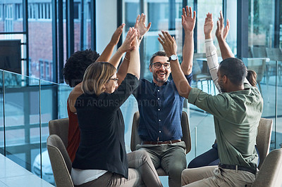 Buy stock photo Shot of a group of businesspeople cheering in an office