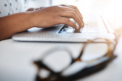 Buy stock photo Closeup shot of an unrecognizable businesswomen working on a laptop in an office
