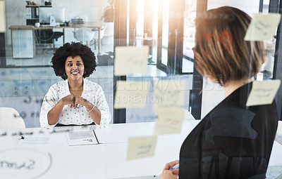 Buy stock photo Shot of a businesswoman having a meeting with her colleague in an office