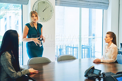 Buy stock photo Cropped shot of an attractive businesswoman addressing her colleagues in the boardroom