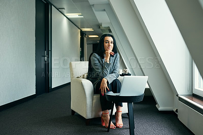 Buy stock photo Full length portrait of an attractive young businesswoman working on her laptop in the office