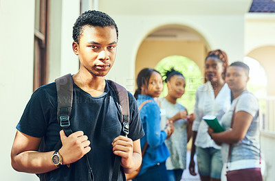 Buy stock photo Cropped portrait of a young male university student looking sad while being bullied on campus