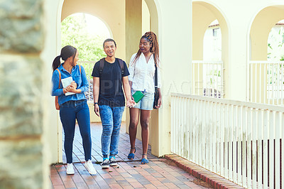 Buy stock photo Full length shot of a group of young university students on campus