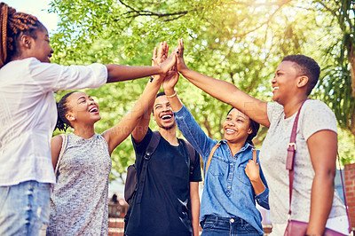 Buy stock photo Cropped shot of a group of young university students high fiving on campus