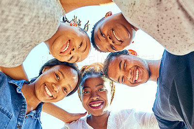 Buy stock photo Low angle portrait of a group of young university students standing in a huddle on campus