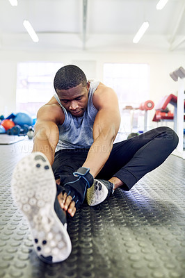Buy stock photo Full length shot of a handsome young athletic man warming up in the gym