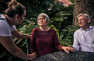 Buy stock photo Cropped shot of a senior couple and their adult daughter in the backyard at home home