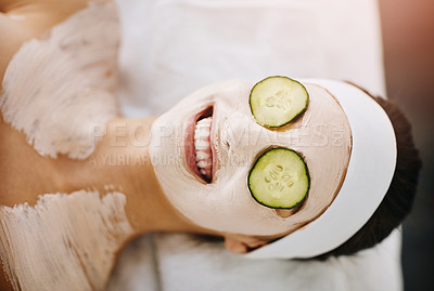Buy stock photo Shot of an attractive young woman getting a facial at a beauty spa