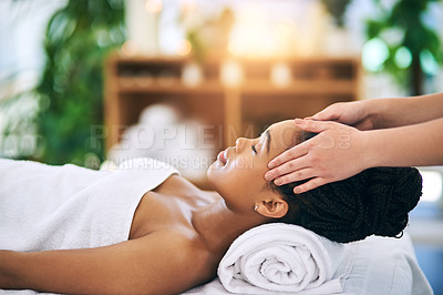 Buy stock photo Shot of an attractive young woman getting a massage at a spa
