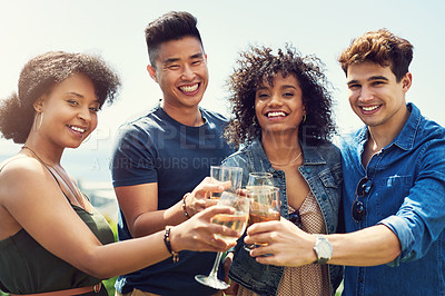Buy stock photo Portrait of a group of friends having drinks and sharing a toast together outside while on holiday