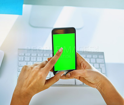 Buy stock photo Shot of an unrecognizable businesswoman using her cellphone at her office desk at work
