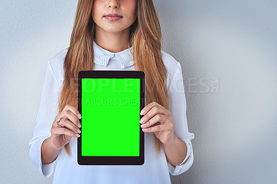 Buy stock photo Shot of an unrecognizable woman holding a digital tablet against a blue background