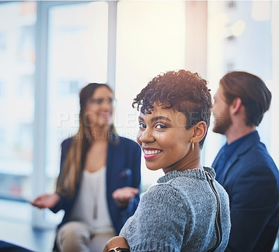 Buy stock photo Portrait of an attractive young businesswoman smiling and posing during a meeting with her colleagues at work