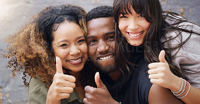 Buy stock photo Portrait of a group of friends posing together with their thumbs up while relaxing outdoors