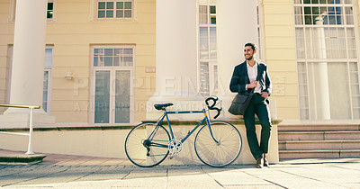 Buy stock photo Full length shot of a handsome young businessman posing next to a bicycle in the city