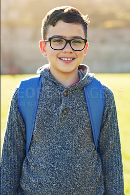 Buy stock photo Portrait of an elementary schoolboy standing on the school lawn outside