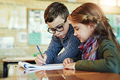 Buy stock photo Shot of two elementary school children working together in class