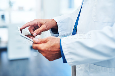 Buy stock photo Closeup shot of a scientist using a digital tablet in a laboratory