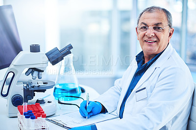 Buy stock photo Portrait of a mature scientist using a microscope in a laboratory