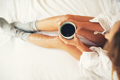 Buy stock photo High angle shot of a relaxed young woman having coffee in her bedroom at home