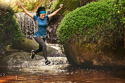 Buy stock photo Shot of a young woman out running in the forest