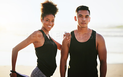 Buy stock photo Portrait of a young couple working out at the beach