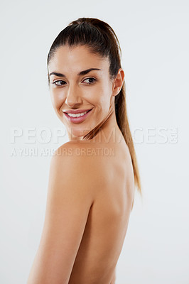 Buy stock photo Studio shot of an attractive young woman posing against a grey background