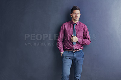 Buy stock photo Studio portrait of a young businessman standing against a gray background