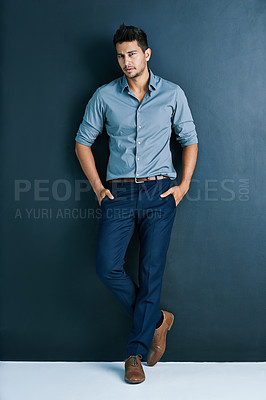 Buy stock photo Studio shot of a young businessman standing against a gray background