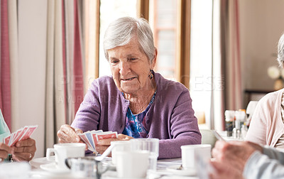 Buy stock photo Shot of a senior woman playing cards in a retirement home