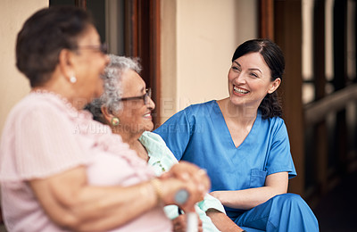 Buy stock photo Cropped shot of a female caretaker talking to her senior patients outside