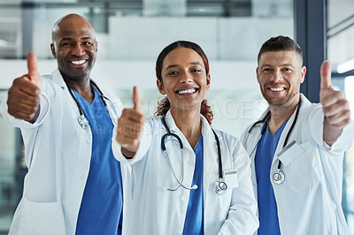 Buy stock photo Portrait of a group of medical practitioners showing thumbs up together