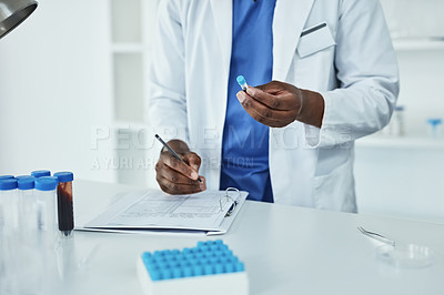 Buy stock photo Closeup shot of a scientist analyzing samples in a lab