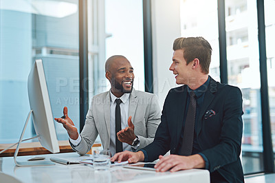 Buy stock photo Cropped shot of two businessmen having a discussion in a modern office