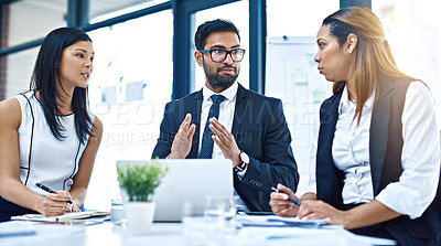 Buy stock photo Cropped shot of a group of businesspeople having a discussion in a modern office