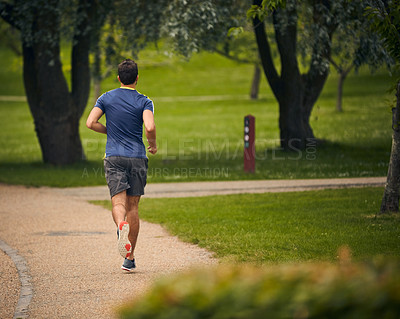 Buy stock photo Rearview shot of a sporty middle-aged man out running