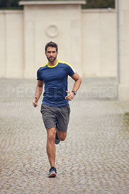 Buy stock photo Shot of a sporty man running outdoors