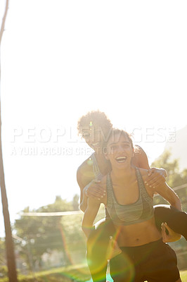 Buy stock photo Cropped shot of a sporty young couple spending the day outdoors
