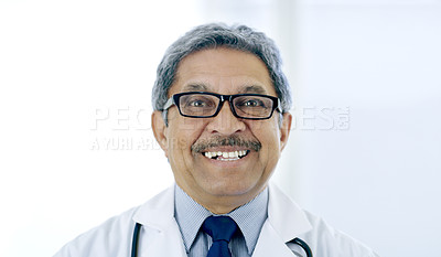 Buy stock photo Cropped portrait of a handsome mature male doctor working in the hospital