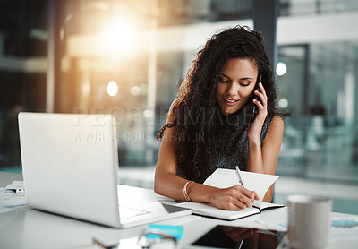 Buy stock photo Shot of a young businesswoman working in an office at night