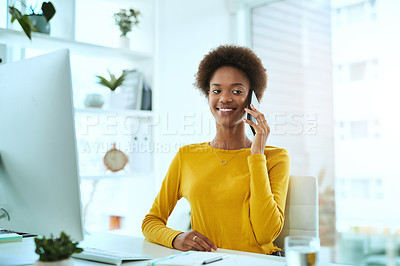 Buy stock photo Portrait of a young designer talking on a cellphone in an office
