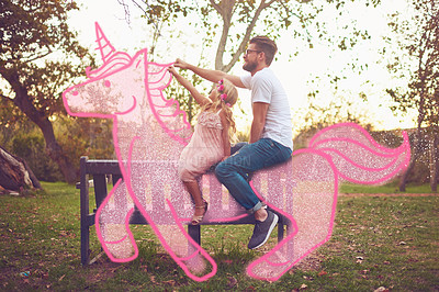 Buy stock photo Shot of a happy father and daughter riding a pink toy unicorn together in a park outdoors